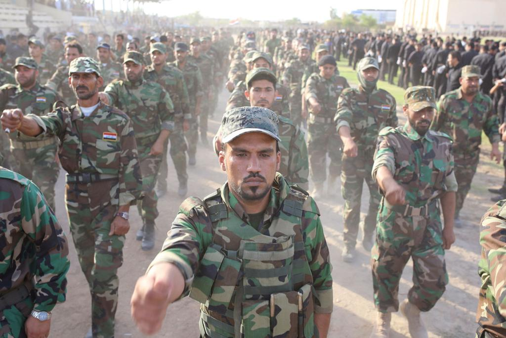 Mehdi Army fighters loyal to Shi'ite cleric Moqtada al-Sadr march during a military-style training in the holy city of Najaf.