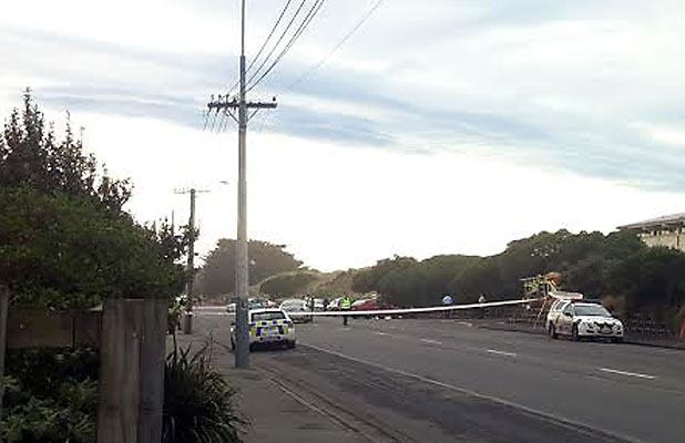 MOTORCYCLIST KILLED: Police tape blocks off the scene of the fatal crash in New Brighton, Christchurch.