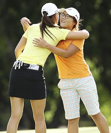 IDOL: Lydia Ko and Michelle Wie hug after completing their round at the ISPS Handa Australian Open last year.