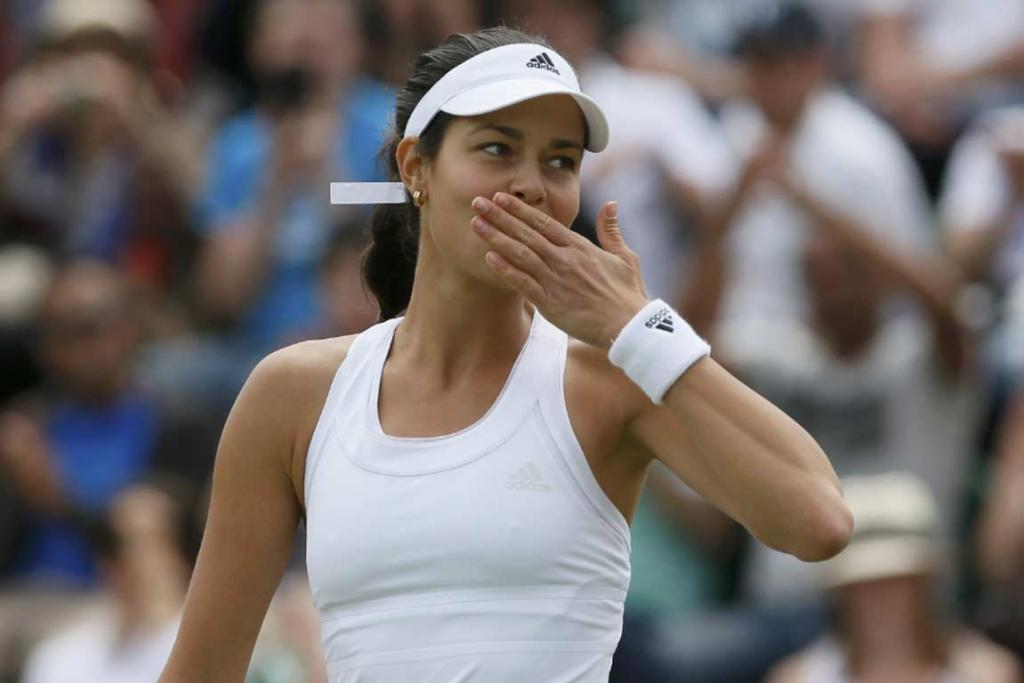 Ana Ivanovic blows kisses to the crowd after her victory over China's Zheng Jie.