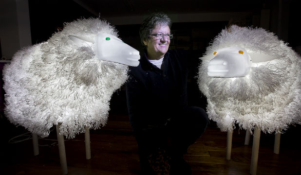 Nelson artist Fleur Stewart with two of her internally illuminated sheep that will be displayed at Light Nelson.