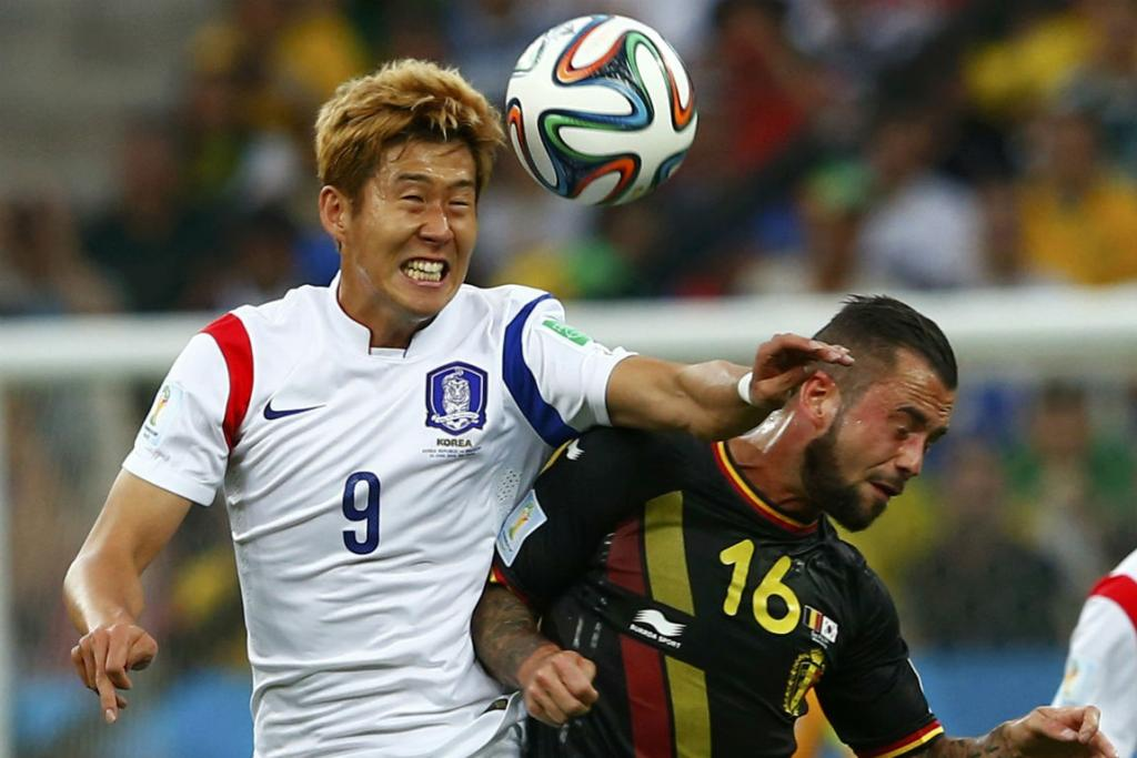 South Korea's Son Heung-min (left) and Belgium's Steven Defour fight for the ball.