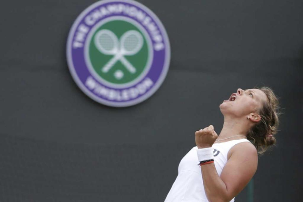 Barbora Zahlavova Strycova, of the Czech Republic, roars after upsetting No 2 seed Li Na in the third round.