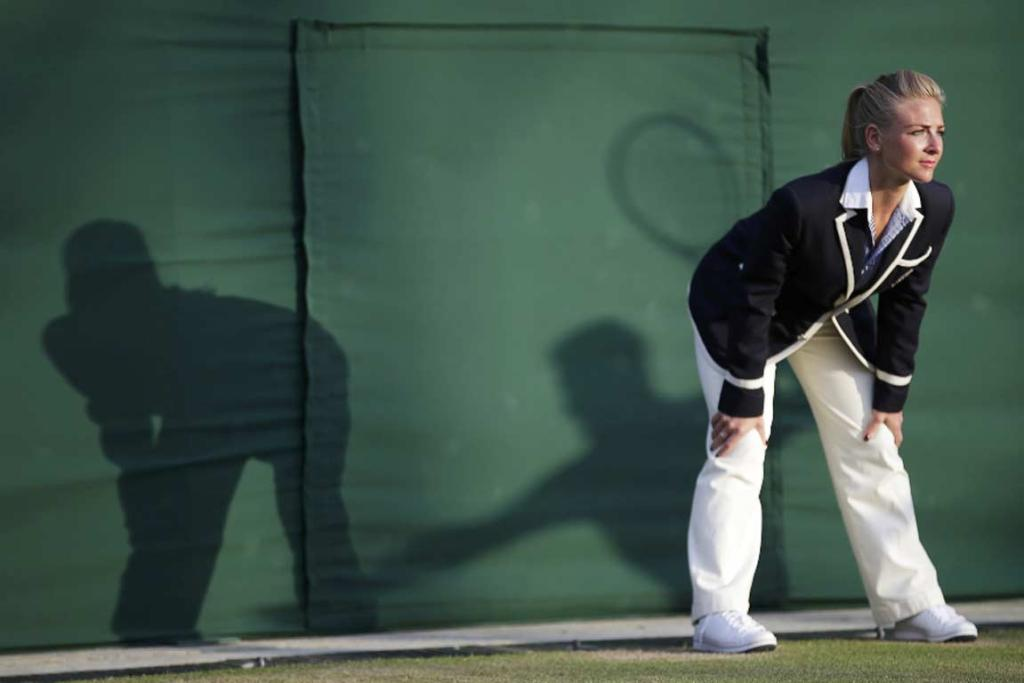 A Wimbledon line judge in action during a match between Marin Cilic and Tomas Berdych.