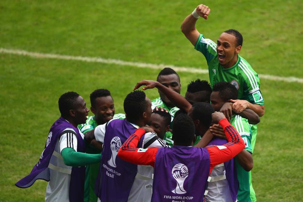 Nigerian players celebrate Ahmed Musa's goal.