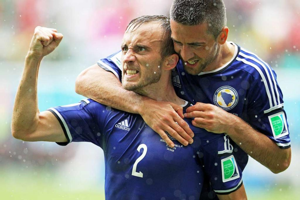 Bosnia-Herzegovina's Avdija Vrsajevic pumps his fist after scoring his country's third goal against Iran.