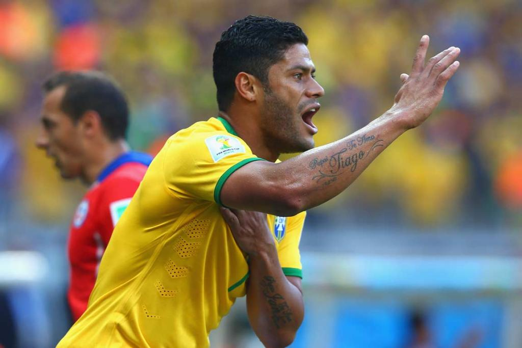 Hulk appeals to the assistant referee after having a goal for Brazil ruled out for a handball.