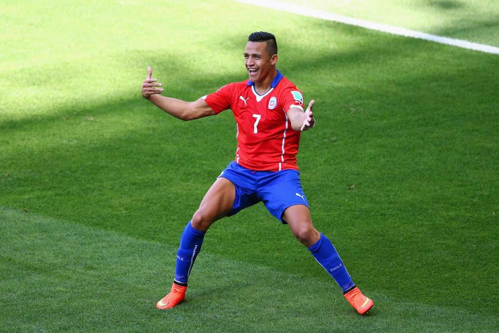 Chile's Alexis Sanchez waits for team-mates as he celebrates his first-half goal against Brazil.