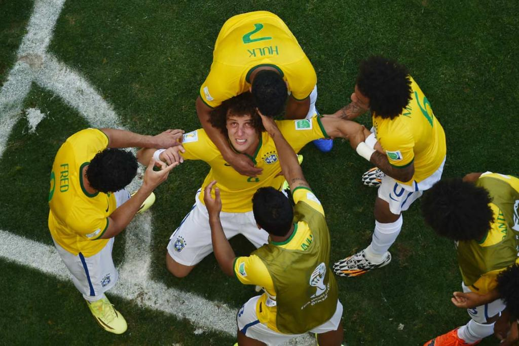 David Luiz looks skyward in celebration of Brazil's first goal, which was later ruled an own-goal.