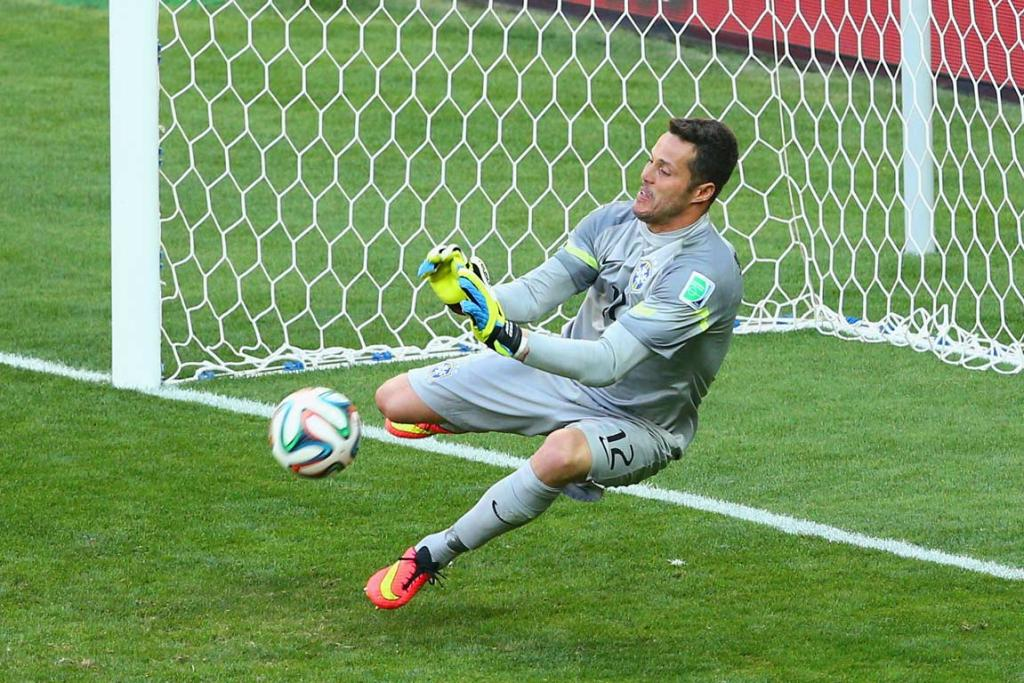 Brazilian goalkeeper Julio Cesar makes one of his two saves in the penalty shootout.