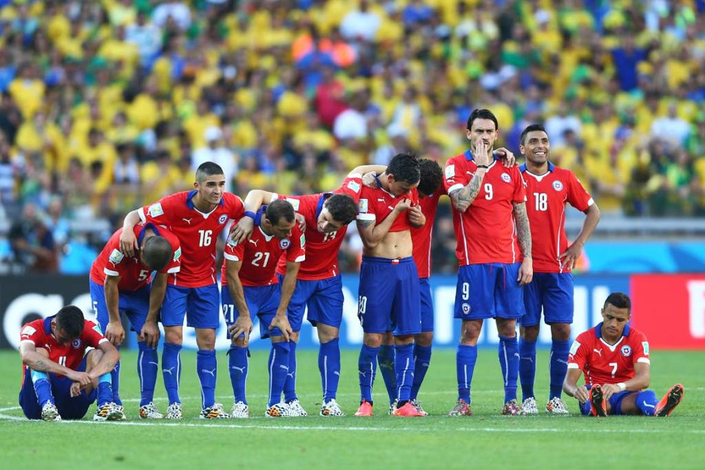 A nervous bunch of Chilean players line up ahead of the penalty shootout.
