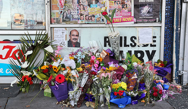 MEMORIAL: Flowers placed outside the Railside Dairy where Arun Kumar was stabbed to death.