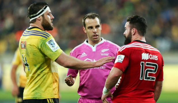 Referee Mike Fraser tells captains Jeremy Thrush and Ryan Crotty (r