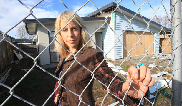 LEFT IN THE LURCH: Erica McLachlan, who owns a property in Storer St in the Silverstream sub division Kaiapoi, says contractors have taken building materials away from the site and out of the house.