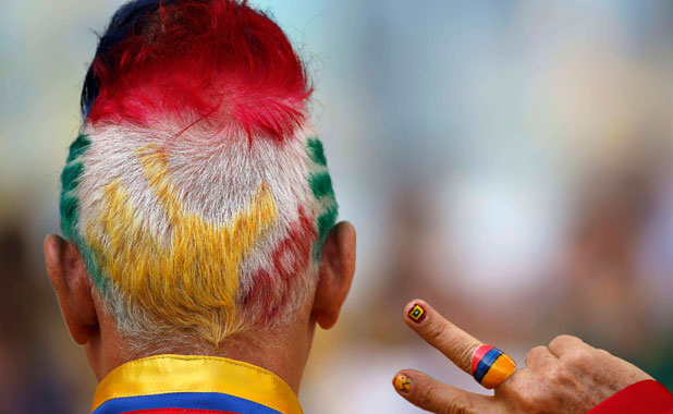WEARING HIS COLOURS: A Colombian fan supporting his team at Maracana stadium in Rio de Janeiro.