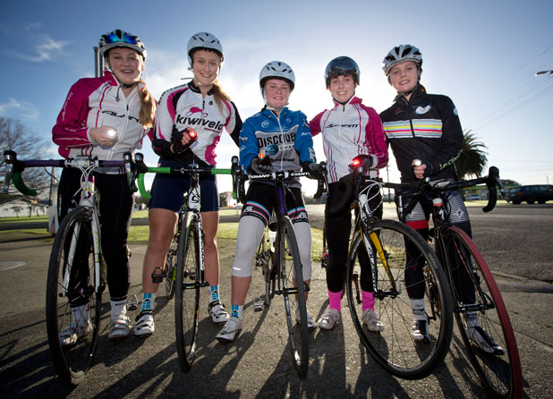 Sun and lights: From left, Simone Davie, 15, Libby Arbuckle, 14, Emily Shearman, 15, Renee George, 17, and Michaela Drummond, 16,  are set to dazzle with their new bike lights, intended to make them safer on the roads.