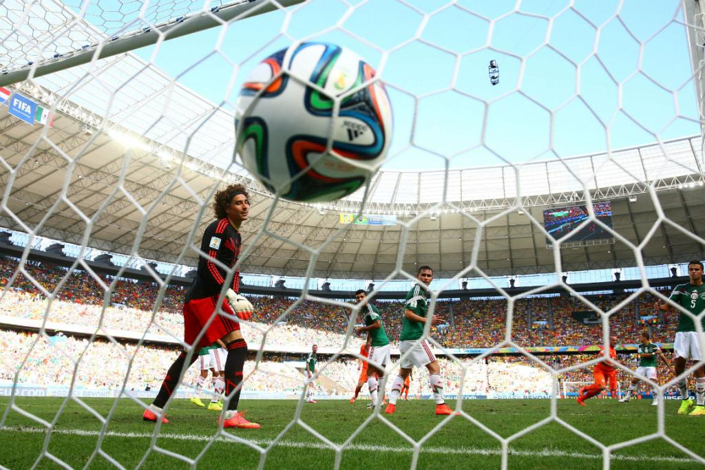 Netherlands midfielder Wesley Sneijder fires his side's equaliser past Mexican goalkeeper Guillermo Ochoa.