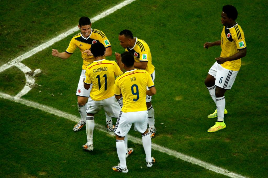 James Rodriguez celebrates scoring his and Colombia's second goal with his team-mates.
