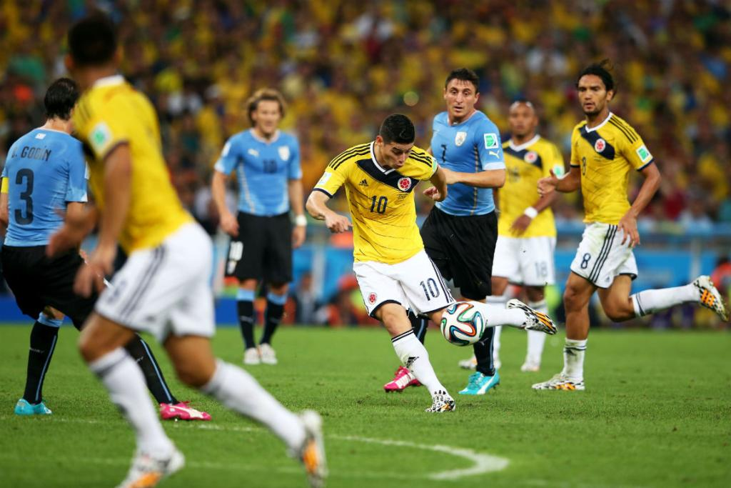 James Rodriguez scores with a sublime volley to put Colombia 1-0 up against South American rivals Uruguay.
