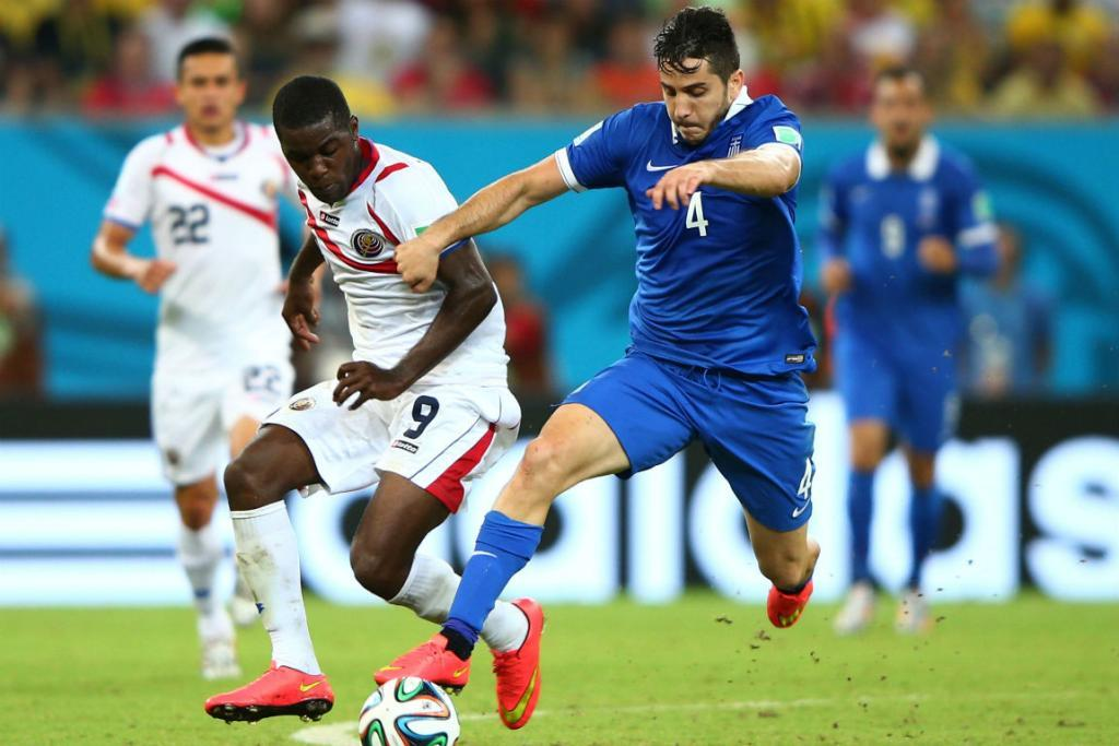 Costa Rica's Joel Campbell and Greece's Konstantinos Manolas compete for the ball.