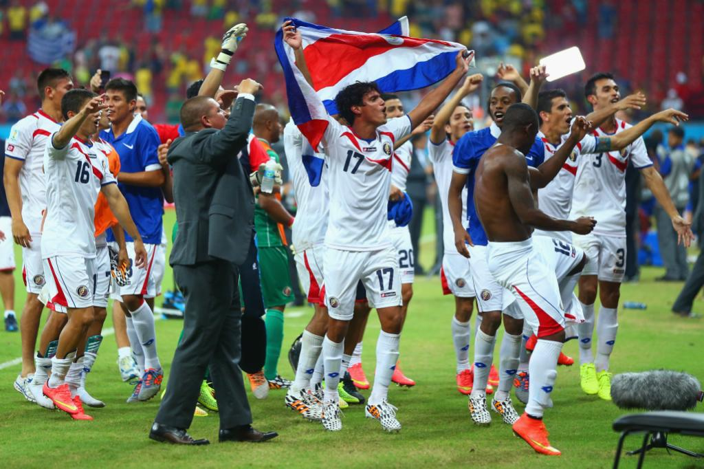 Costa Rica's Yeltsin Tejeda celebrates with team-mates after defeating Greece in a penalty shootout.