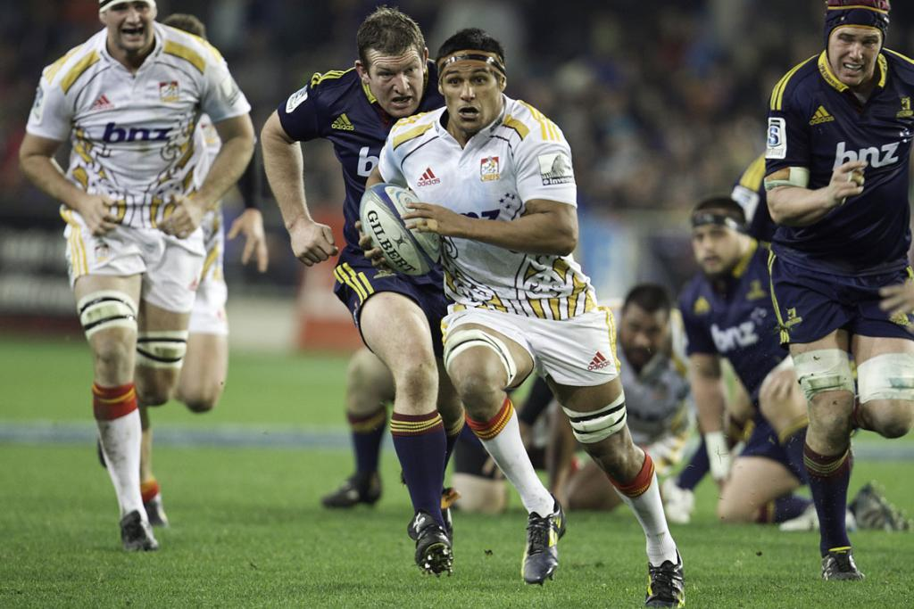 Tanerau Latimer of the Chiefs makes a break during his side's Super Rugby clash with the Highlanders at Forsyth Barr Stadium in Dunedin.