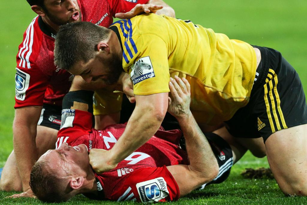 Andy Ellis of the Crusaders and Dane Coles of the Hurricanes scuffle during their round 17 Super Rugby match.