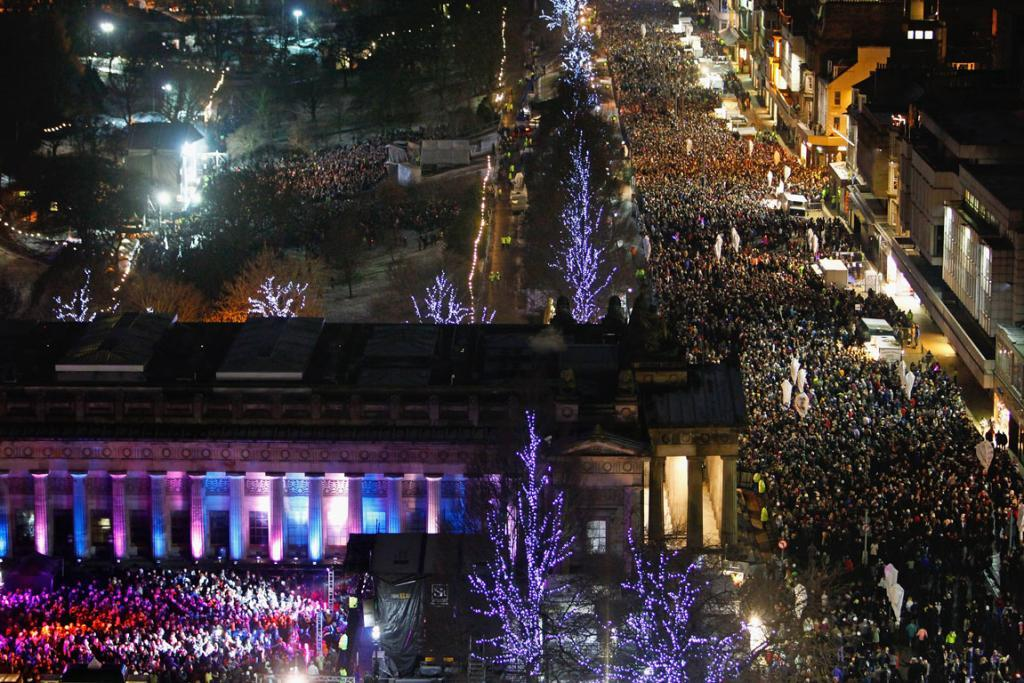 Singing Lang Syne at Hogmanay : New Year revellers gather on Princes Street during the Hogmanay party.