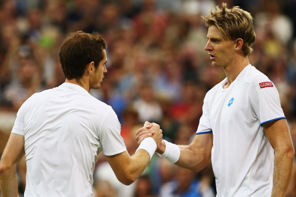 Andy Murray of Great Britain shakes hands with Kevin Anderson of South Africa after their fourth round match on day seven at Wimbledon.