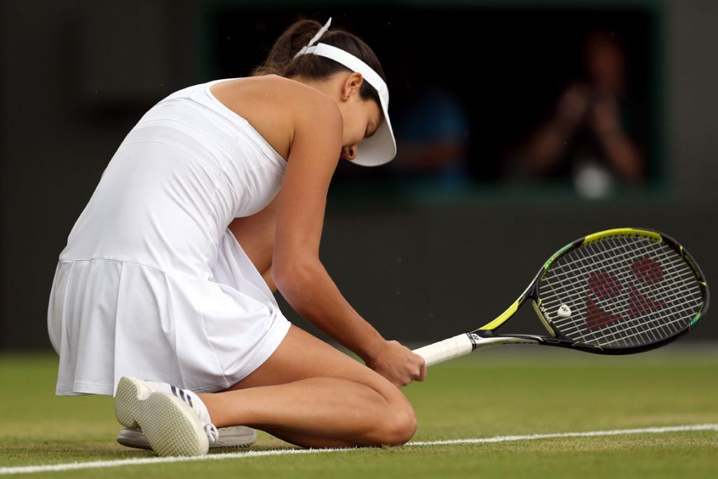 Ana Ivanovic of Serbia is dejected after losing her fourth round match against Sabine Lisicki of Germany at Wimbledon.