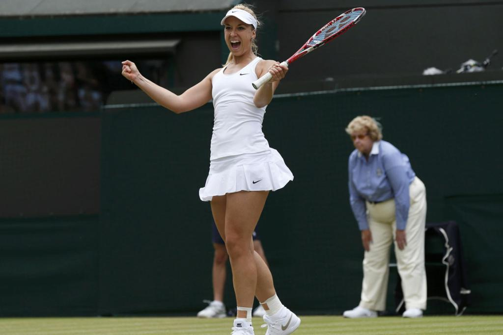 Sabine Lisicki of Germany reacts after defeating Ana Ivanovic of Serbia at Wimbledon.