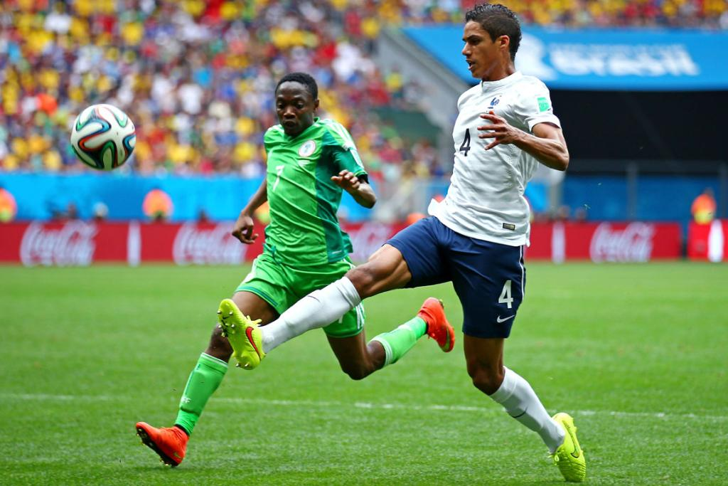 Raphael Varane of France controls the ball against Ahmed Musa of Nigeria during their clash at Estadio Nacional in Brasilia, Brazil.