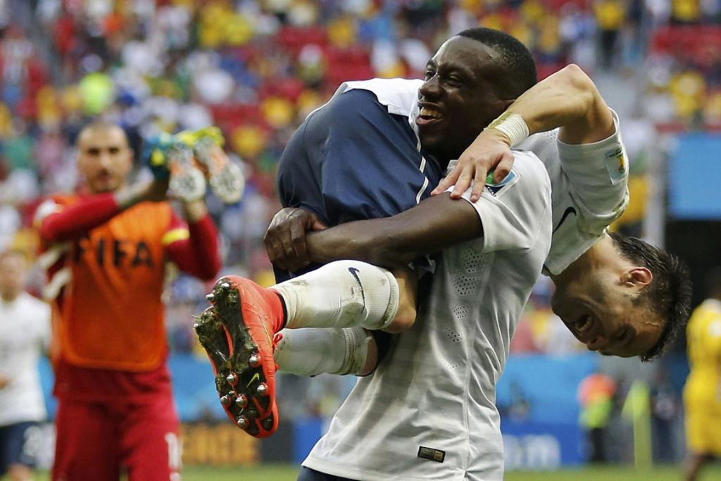 France's Blaise Matuidi (14) and Mathieu Valbuena celebrate after winning their World Cup round of 16 game against Nigeria at the Brasilia national stadium in Brasilia.