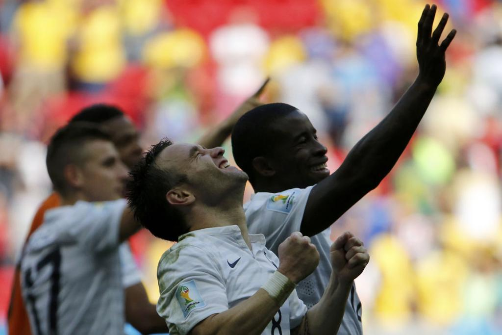 France's Mathieu Valbuena and Rio Mavuba (right) celebrate after winning their World Cup round of 16 game against Nigeria.