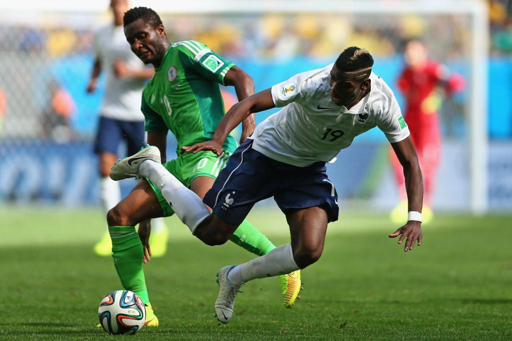 John Obi Mikel of Nigeria challenges Paul Pogba of France during their round of 16 match at Estadio Nacional in Brasilia, Brazil.