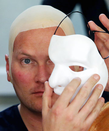 PHANTOM: Actor Chris Crowe in the early stages of his transformation into the Phantom – a process that takes two hours of work by makeup artists Jacqui Stevenson and John Bannister