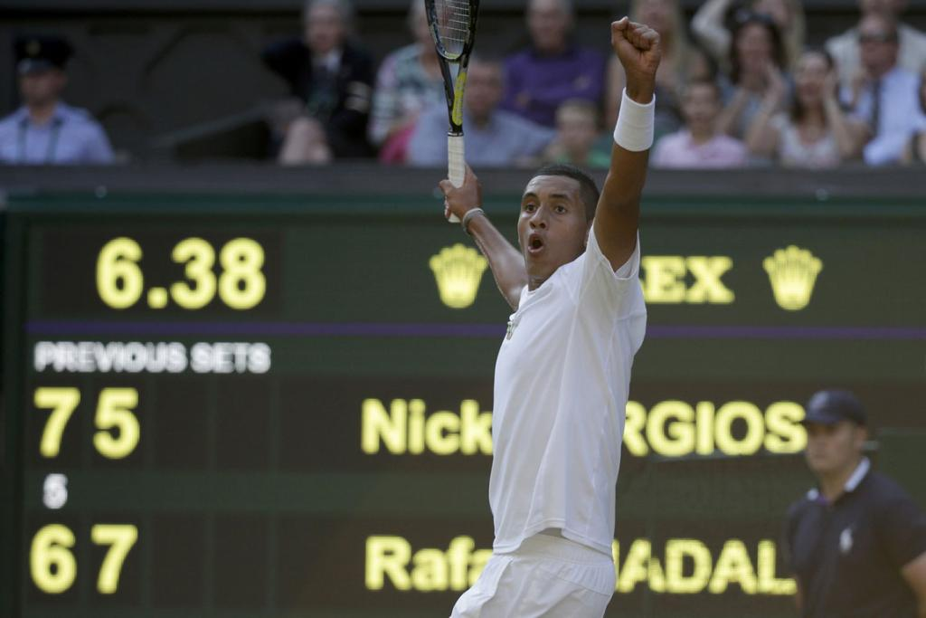 Nick Kyrgios of Australia reacts to winning the third set tie-break during his men's singles match against Rafael Nadal of Spain at Wimbledon.