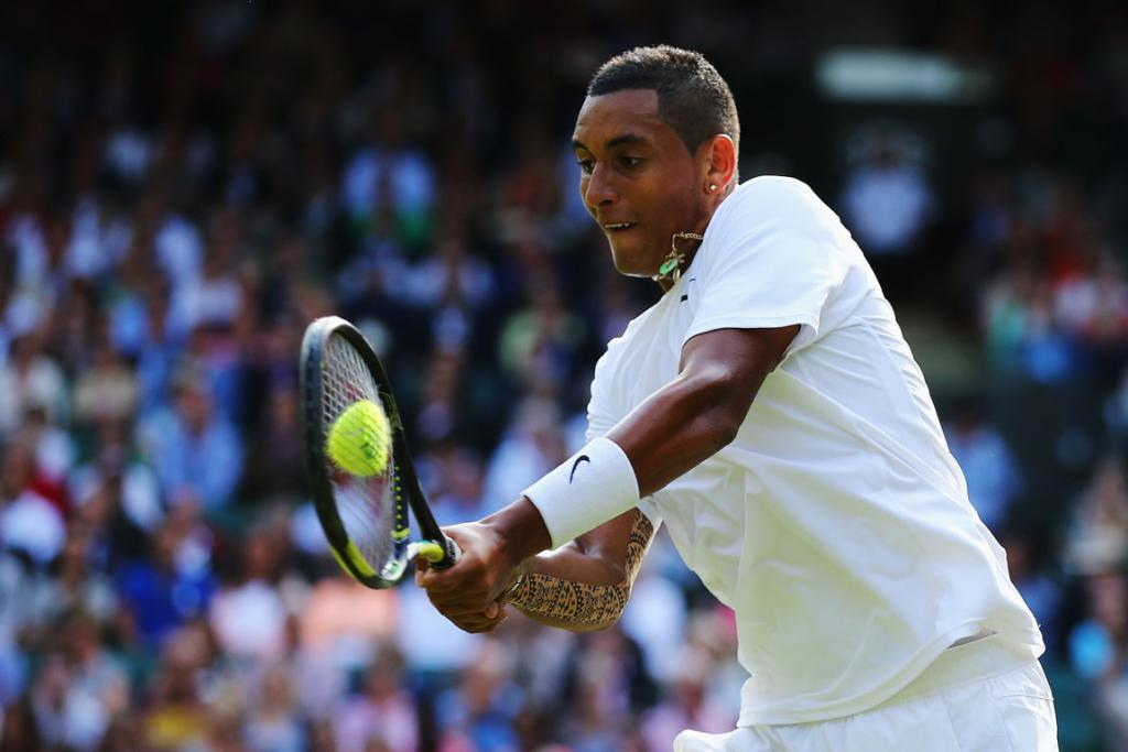 Nick Kyrgios of Australia plays a backhand return during his clash with Spain's Rafael Nadal in the fourth round at Wimbledon.