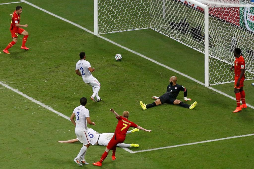 Belgium's Kevin De Bruyne raises his arms in celebration as he watches his strike roll into the net.