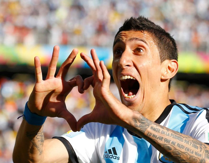 Argentina's Angel Di Maria sends his love to the crowd while celebrating scoring against Switzerland in the round of 16.