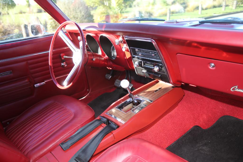 The inside matches the out, with a red and chrome steering wheel, red seats and red dash.