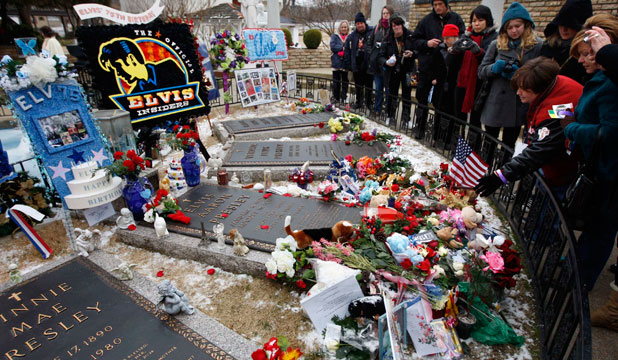 REMEMBERING ROCK: Fans visit the grave of Elvis Presley during his 75th birthday celebration in the meditation garden at Graceland in Memphis, Tennessee.