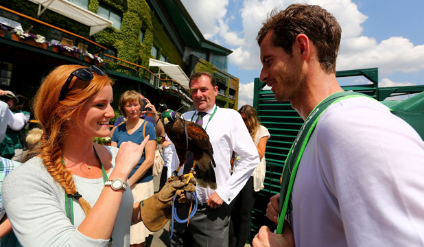 CELEBRITY PERKS: Rufus and handler Imogen Davis meet British tennis star Andy Murray.