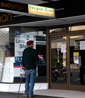 END OF AN ERA: A passerby stops to read the liquidation sign at Everyman in Hardy St Nelson.