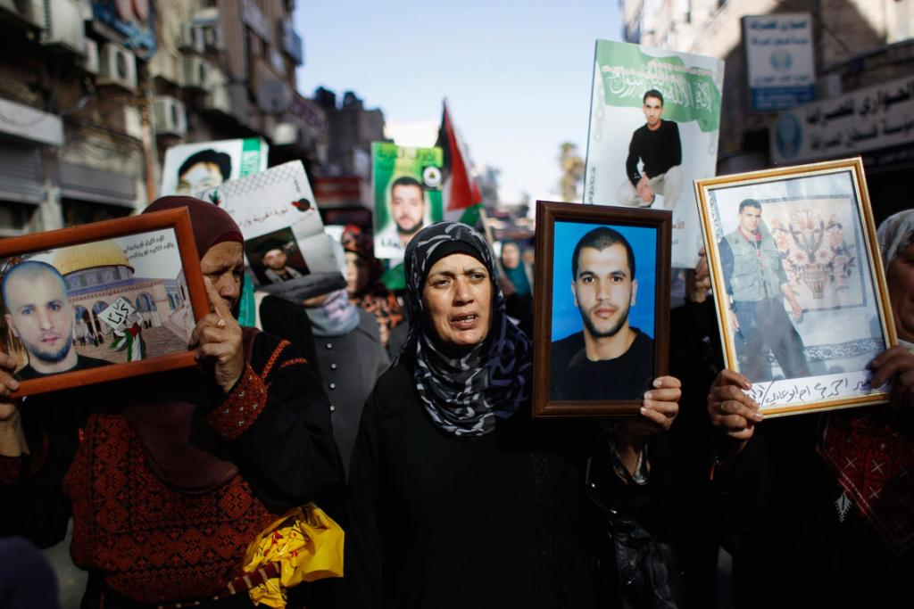 At the time of the kidnapping, Arab shopkeepers in Jerusalem had shut down in solidarity with the 200 or so Palestinian prisoners held without charge by Israel, who are in the midst of a hunger strike. A protest by the families of the prisoners is shown. The hunger strike has since ended.