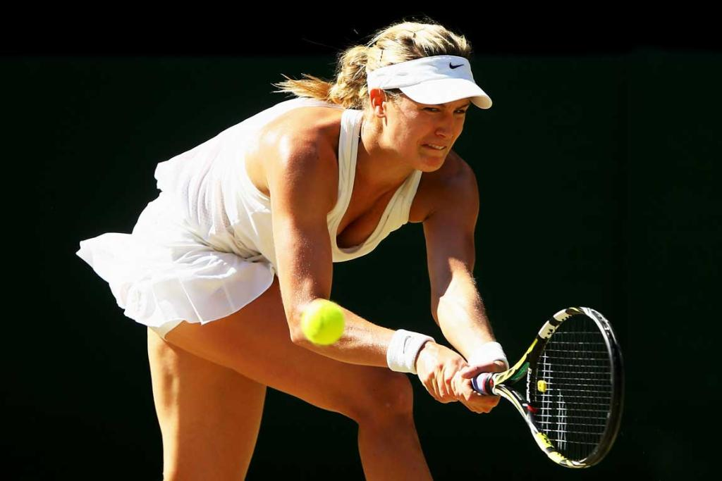 Eugenie Bouchard blasted past Simona Halep after a first-set tiebreaker to reach the Wimbledon final.