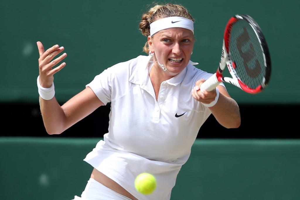 Petra Kvitova of the Czech Republic plays a forehand return during her win over compatriot Lucie Safarova at Wimbledon.
