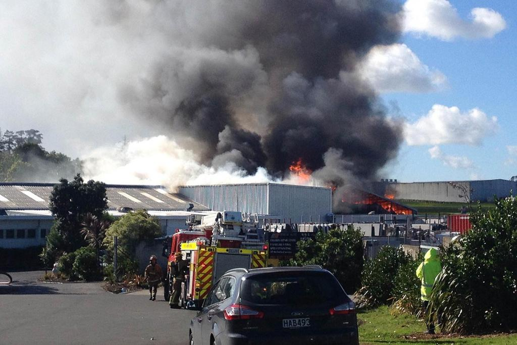 Firefighters battle the blaze, located in a bitumen tank next to a building at the Thermakraft premises.