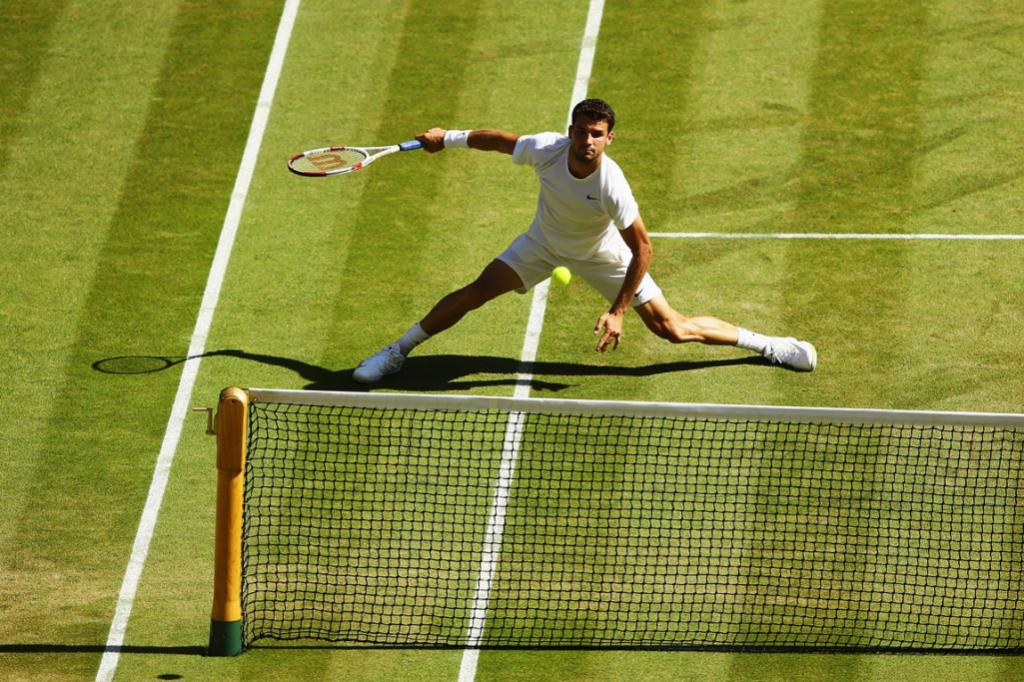 Bulgarian Grigor Dimitrov shows his athleticism in the Wimbledon semifinals.