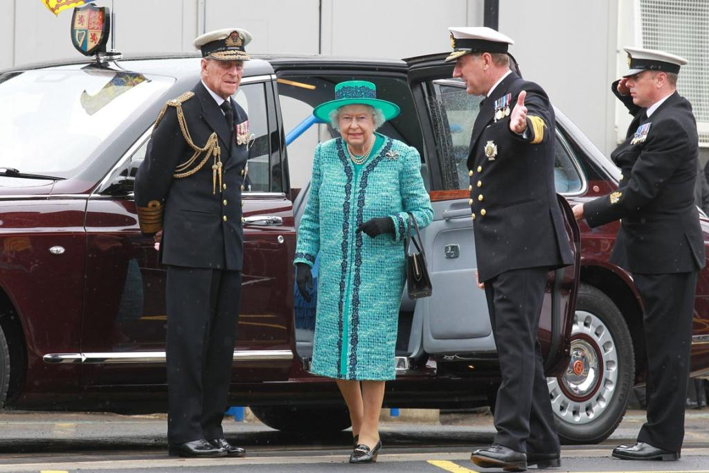 Queen Elizabeth II and Prince Philip, Duke of Edinburgh arrive for the formal naming ceremony for HMS Queen Elizabeth, the Royal Navy's biggest ever ship.
